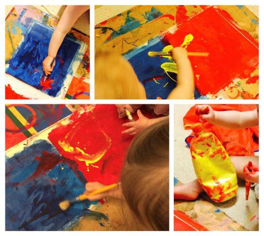 Barnhender maler med pensel