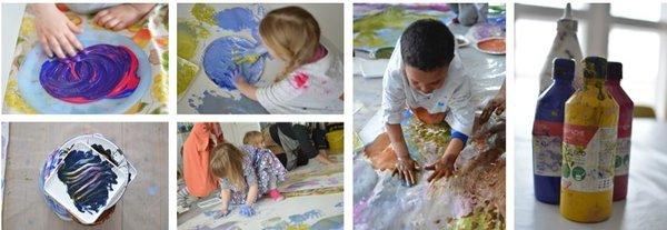 Barn maler med hendene på store flater.