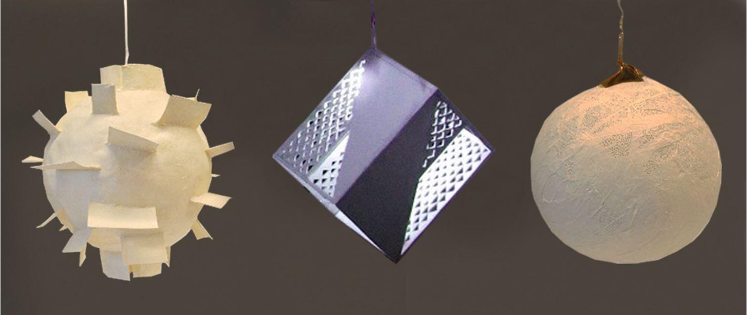 Tre ulike lysobjekter med kule- og kubisk form